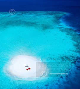 Aerial view of a sandbank and turquoise waters in the Maldives - stock photo