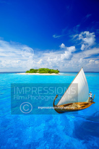 Maldives, sailing boat and tropical island