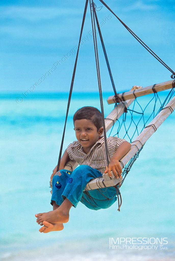 portrait of a maldivian child in a joali on a Maldives local island