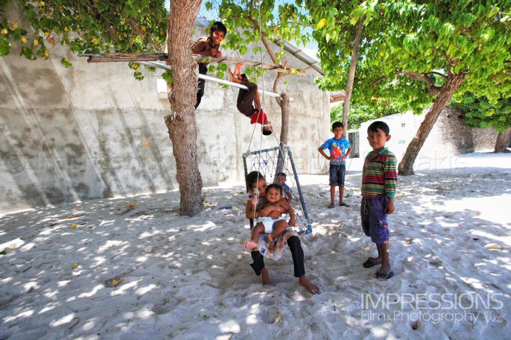 photo of maldivian children playing on a Maldives local island