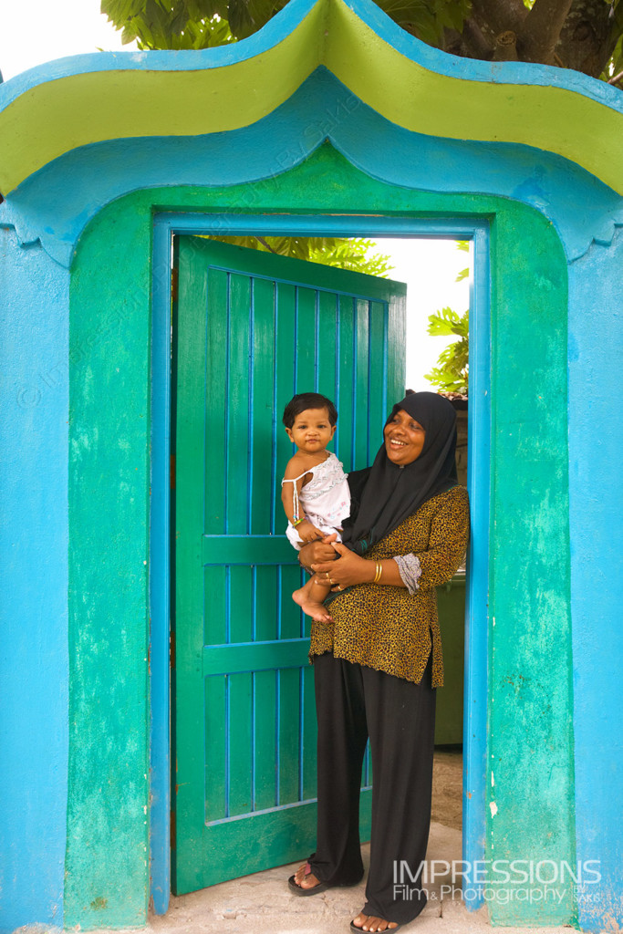 photo of a happy mother and her young baby girl on a Maldives local island - photos of the people of Maldives series