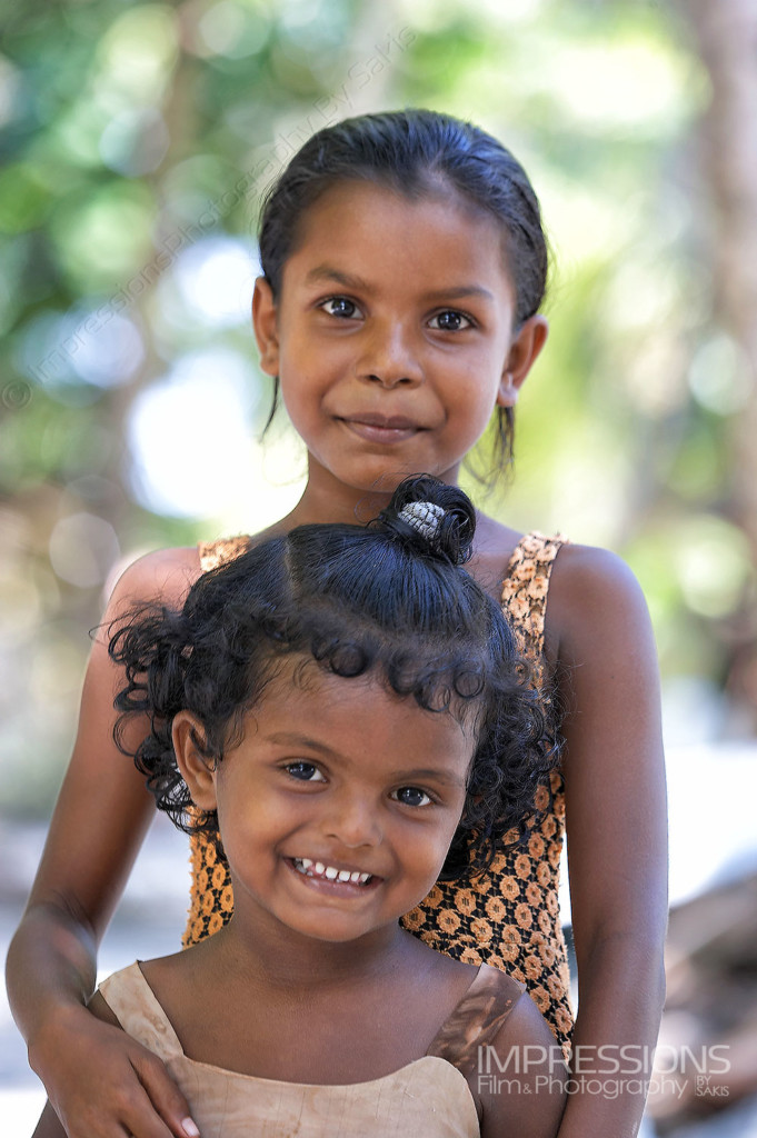 portrait of young sister girls on a Maldives local island