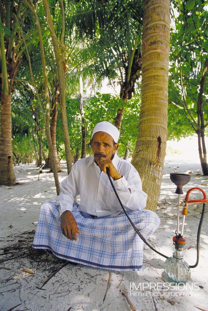 portrait of a man relaxing with his hookah Maldives local island - photos of the people of Maldives series